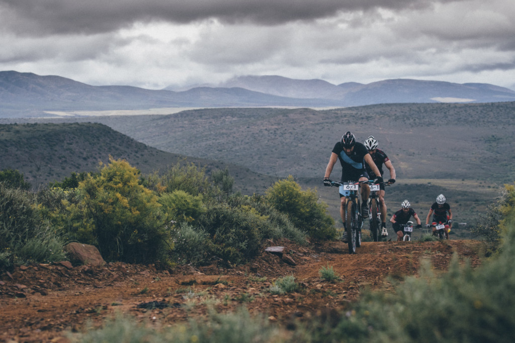 { 00897525} Riders summit the first big climb of stage 3 of the 2015 Cape Pioneer Trek between Oudtshoorn and De Rust. http://capepioneer.co.za/ Photo by Ewald Sadie